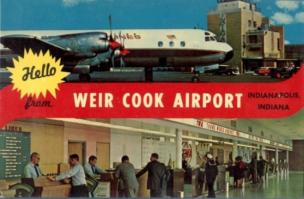 A postcard advertising Weir Cook Airport. Notice the conveniently place ash trays at the ticketing counter (courtesy eBay)