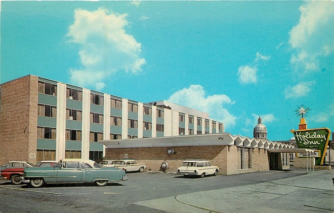 The rotunda of the Indiana State Capitol can be seen in the distance of this early sixties shot of the downtown Holiday Inn