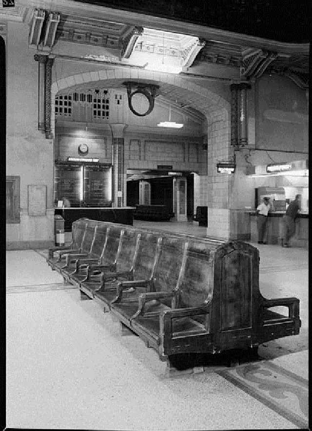 A lone customer stands next to a security guard at a lunch counter at Union Station in 1970. Notice the crumbling plaster at the top of the archway. (Courtesy Library of Congress)